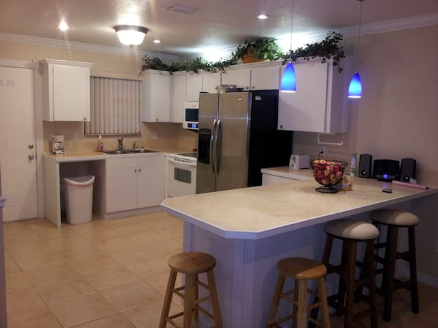 Kitchen view, countertop table with full kitchen microwave stove refrigerator coffee maker and all cooking pots and pans needed for the perfect meal.