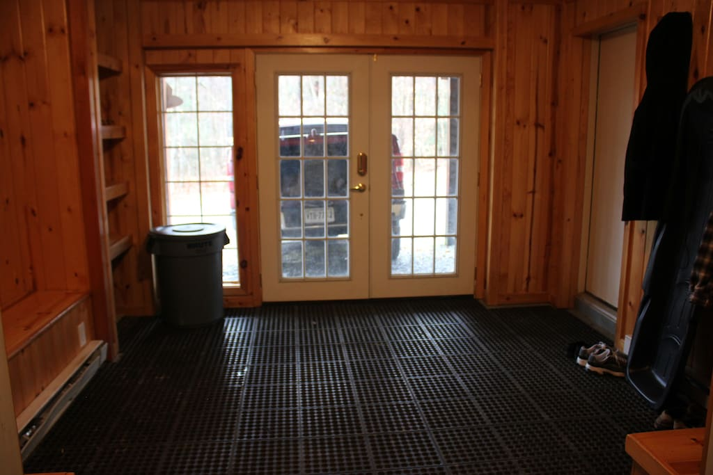 Lower level entry with ski room with mats and ski storage
