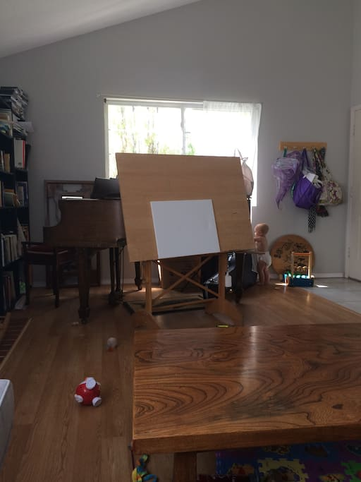 Living room photo 2, you can see piano, easel, and my baby!