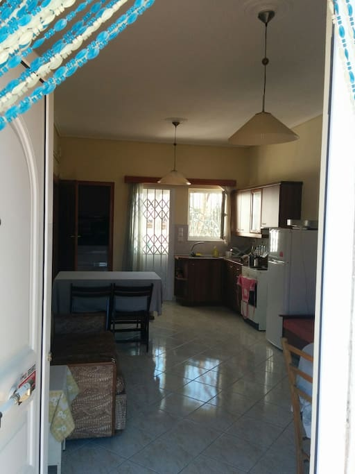 The kitchen and the livingroom (view from the main entrance door)