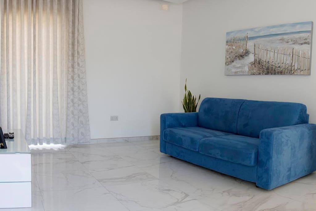 Living area includes TV and Wifi.  Sofa can be turned into sofabed to accommodate guests