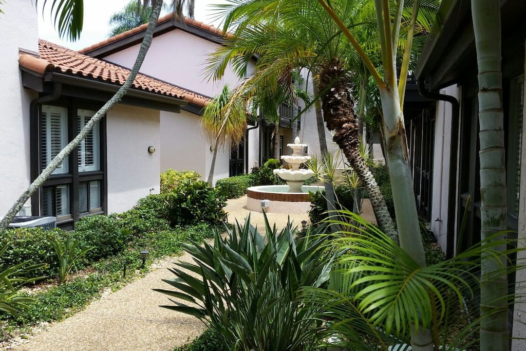 One side of the common area courtyard. Very lush and tropical, features two fountains. Walk through this to your villa.