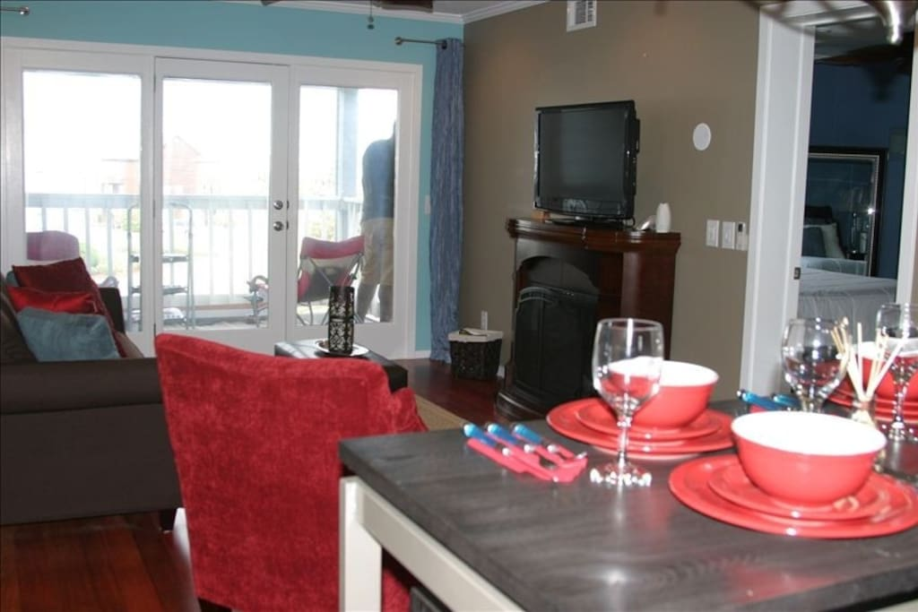 Living room/dining room at Tranquility. Wifi, surround sound, recessed lighting, flat screen TV with DVD player, fireplace.