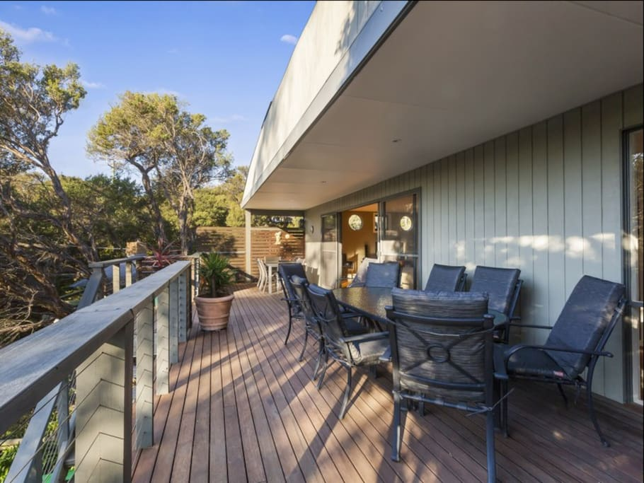 Large Deck With BBQ and Outdoor Settings