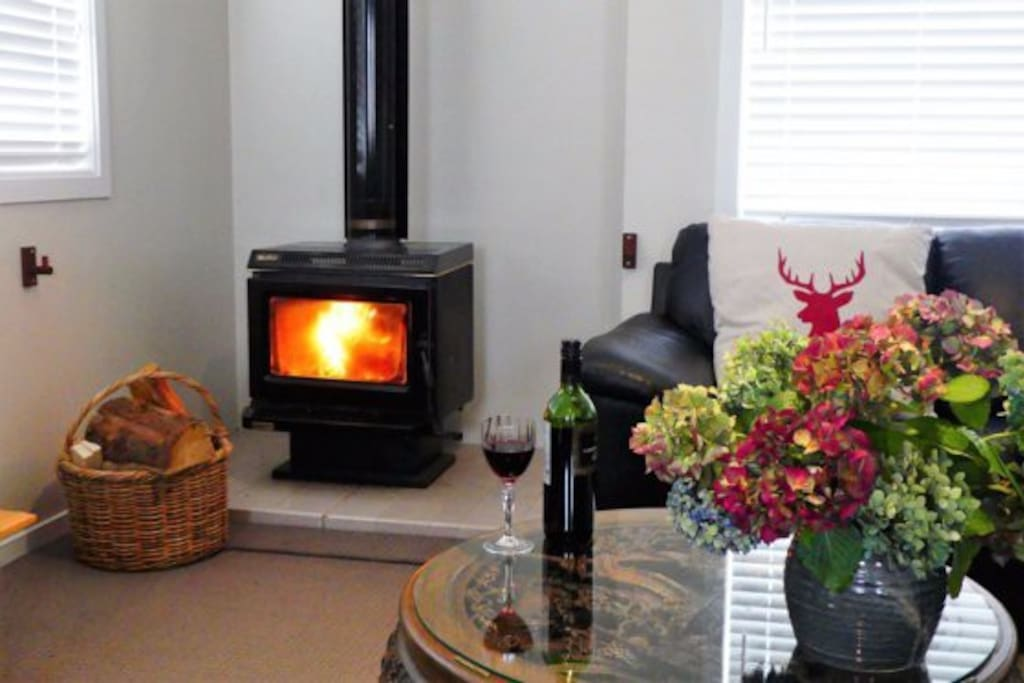 Enjoy the warmth of a roaring fireplace; an ideal place to feel at home.  (Fireguard provided)