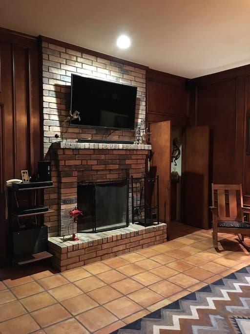 Den with Fireplace and Large Screen TV