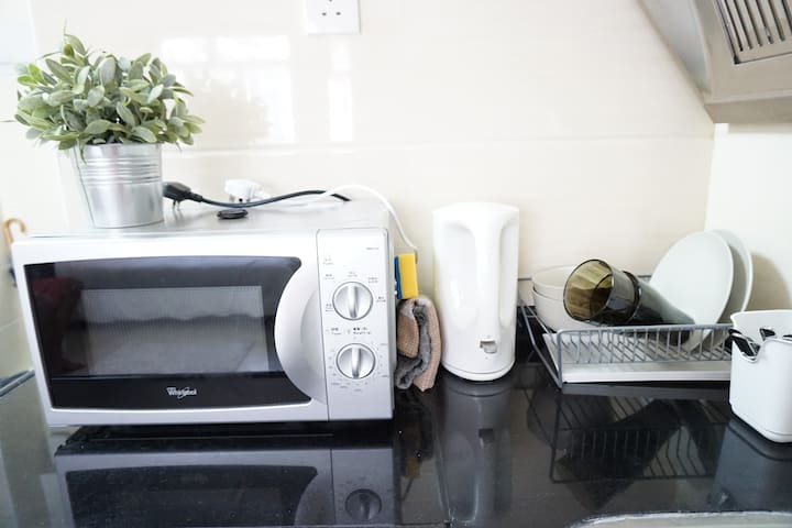 Mini kitchen , Provide the cups ,keetle,and microwave.
