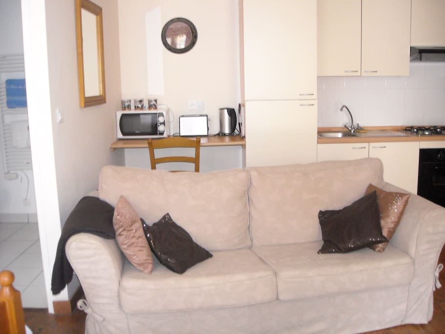 Ample seating and well equipped kitchen area.