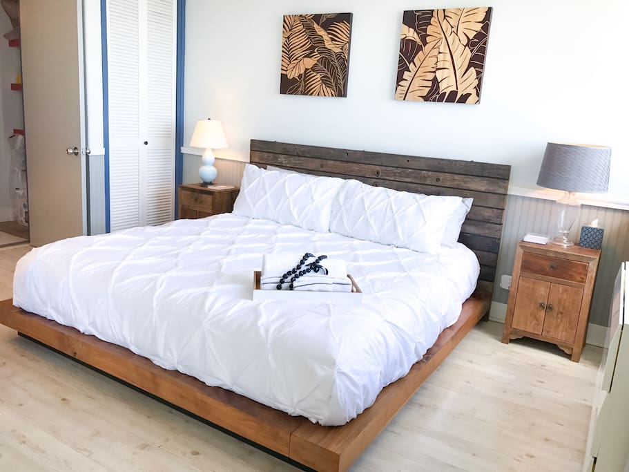 Spacious bedroom features a king sized bed with a memory foam mattress
