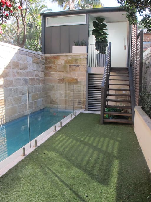 View of pool and yard. Studio is at the top of the stairs