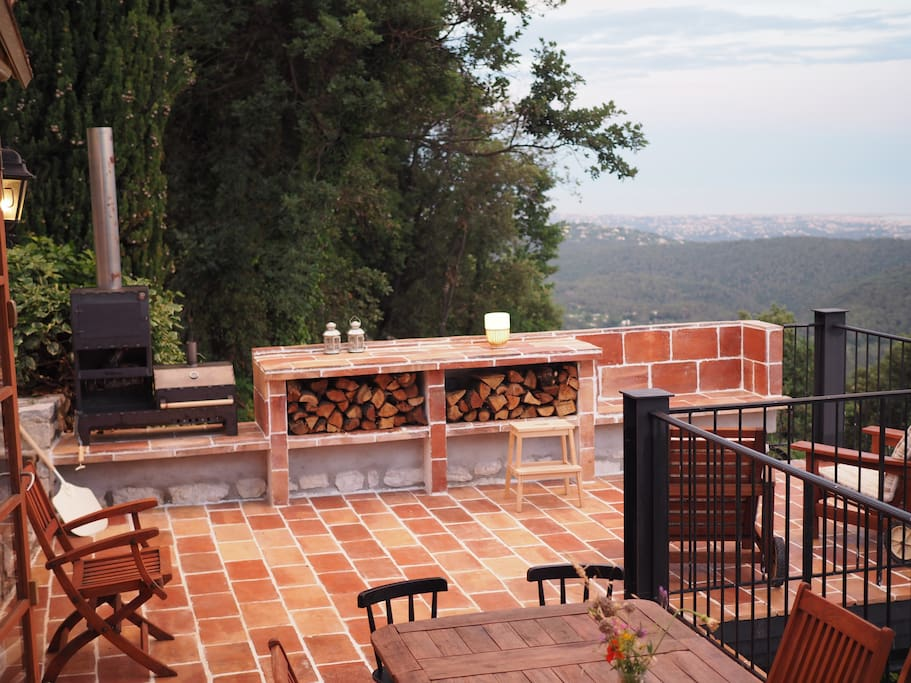 New extended balcony with outdoor kitchen and BBQ/oven/fireplace