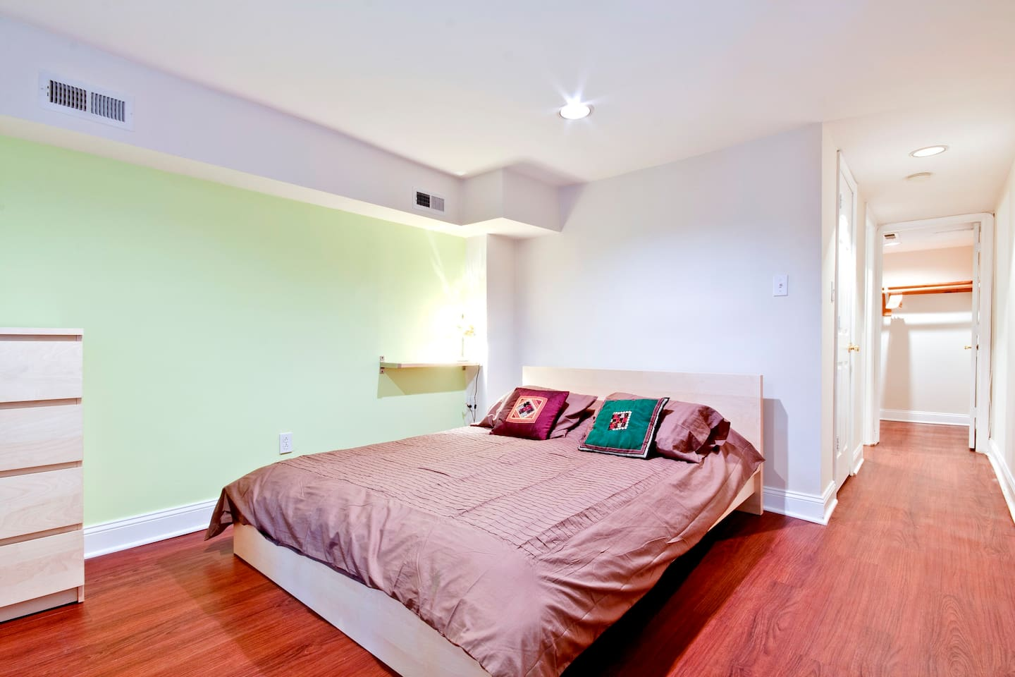 Bedroom with queen size bed, four drawer dresser and walk-in closet.  Includes linens, comforter, pillows.