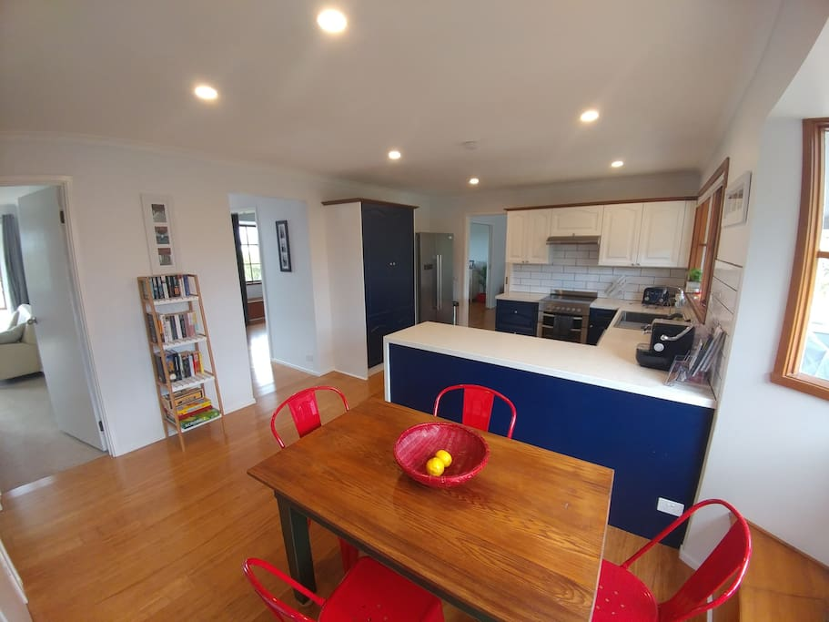 Spacious Kitchen with large fridge/freezer and kids meals area.