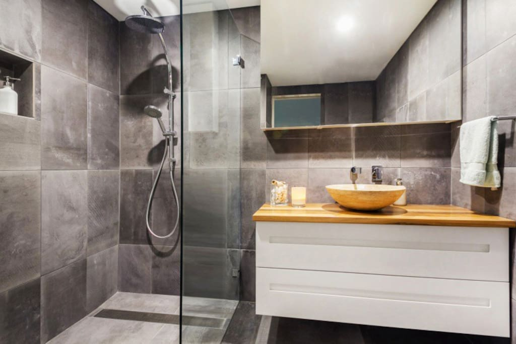 Beautifully appointed bathroom with large walk in rain shower