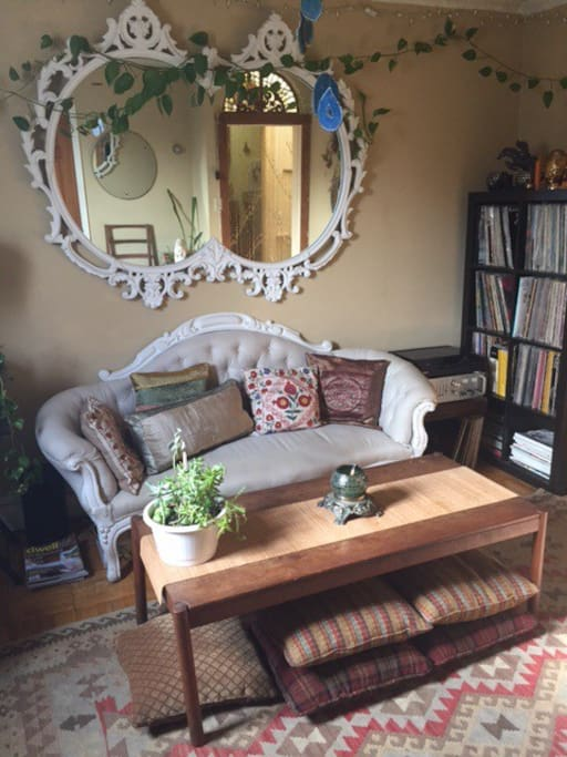 Vast record collection and floor pillows for lounging or working at table