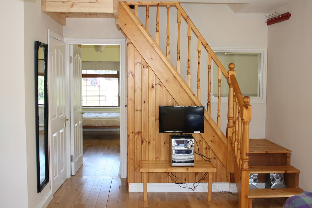 Pine staircase to the cosy loft bedrooms, abundance of natural light