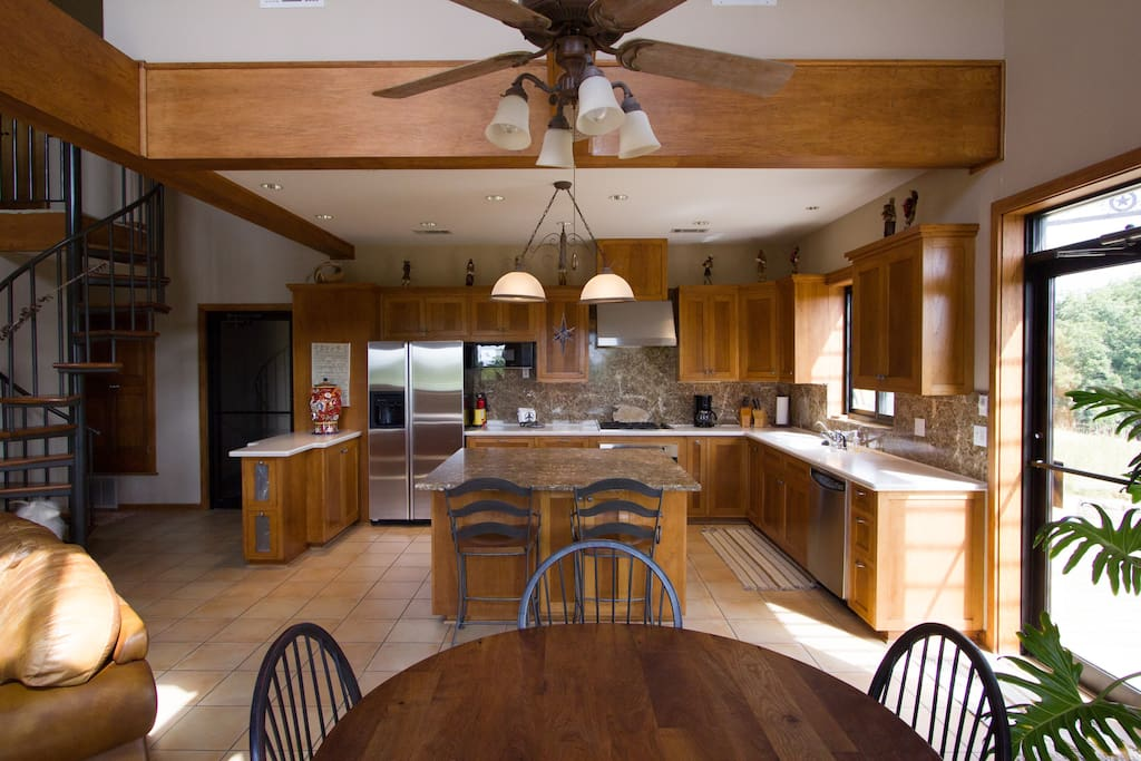 Spacious kitchen overlooking the vineyard for serene meal peparation.
