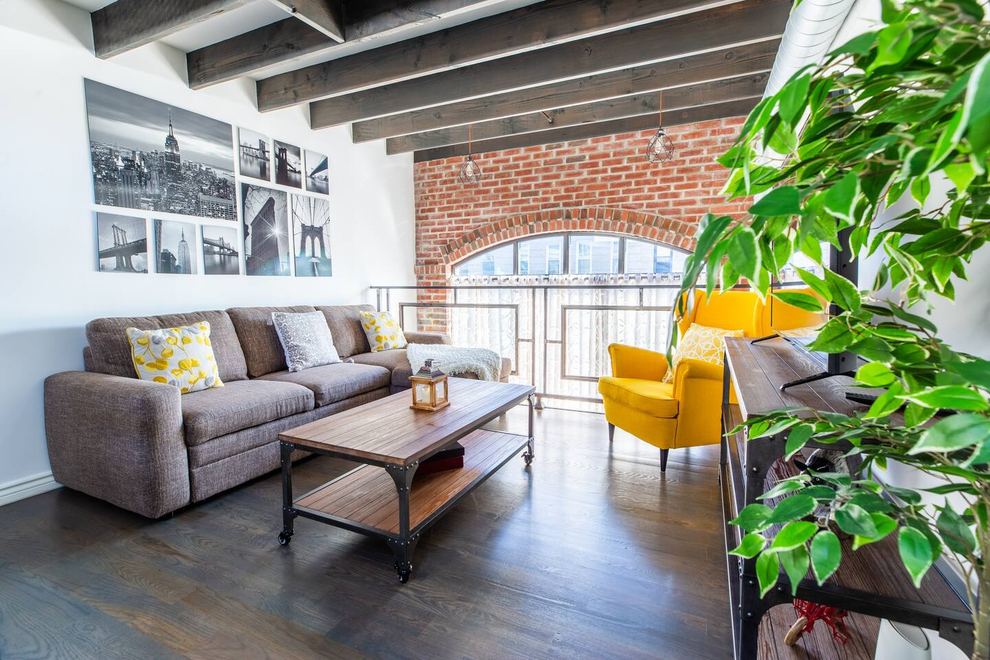 """(Living Room) Located on the duplex level of the loft. We offer a 50"""" Smart TV with access to local channels and apps like Netflix, HBO, Prime and more. Queen Size Sofa Bed with extra blankets and pillows. Beautiful window view of the neighborhood."""