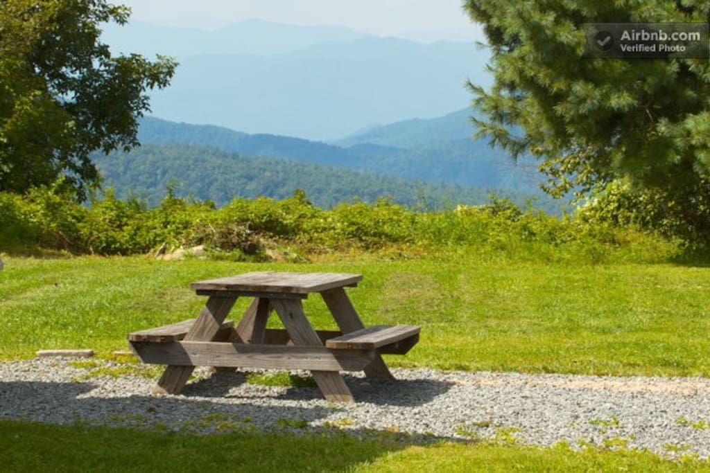 Picnic table on the grounds with majestic mountain views.