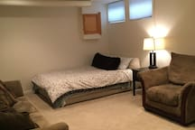 Basement with additional sitting area and queen air mattress