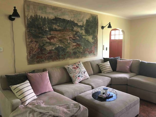 An inviting & well decorated living room with the biggest & most cozy couch! It will be hard not to spend all of your time in this room! Roku TV provided with access to all of your favorite streaming apps!
