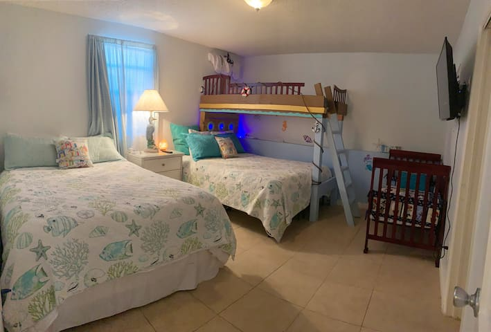 2nd bedroom has two queen beds, a twin bunk and a toddler bed