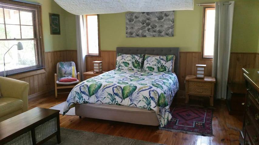Queen bed and quiet reading corner.