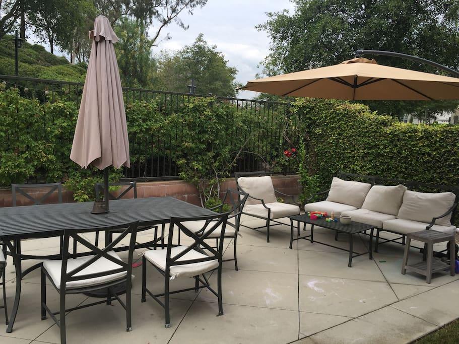 Backyard patio (seats 10) facing quiet trail.