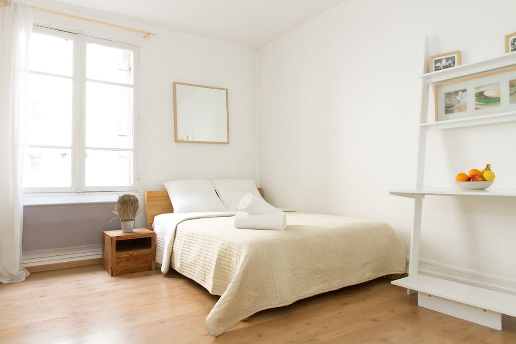 The spacious bedroom with a comfortable double bed