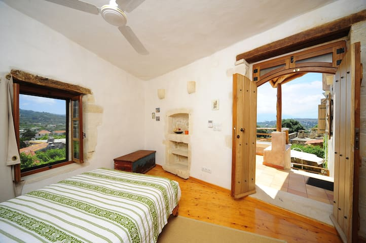 The separate bedroom with the double-bed and the en-suite bathroom accessible from the veranda
