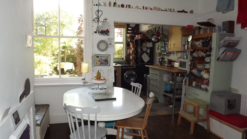 Shared use of dining kitchen looking onto garden