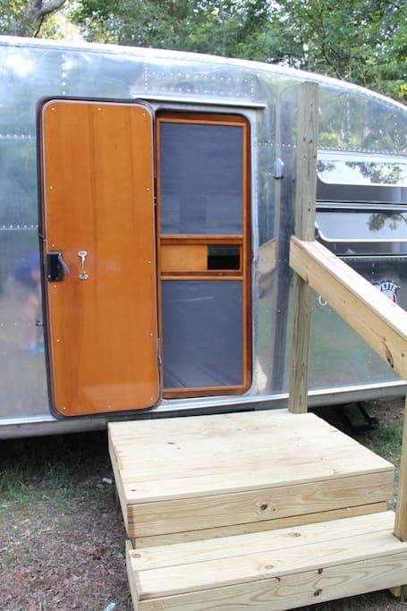 The entry door and wood screen door.