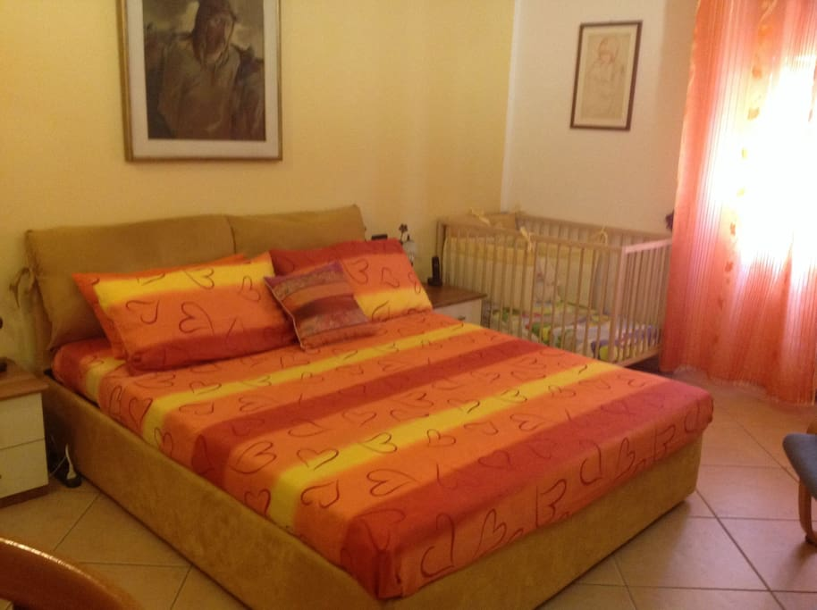 The comfortable bedroom with a cot for a Baby