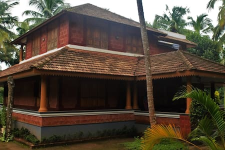 Poonthanam Homestay-river facing A/C family suite
