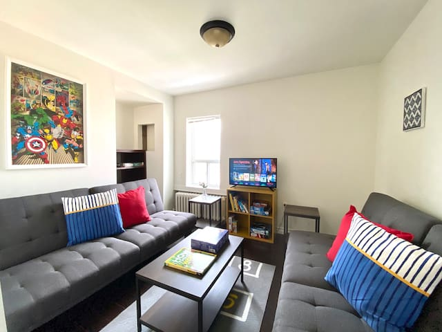 Hang out in our 2nd floor living room, super hero themed living room with kid friendly games, puzzles and books, two click clack futons, and our HD TV with Netflix, Disney channel and Roku.