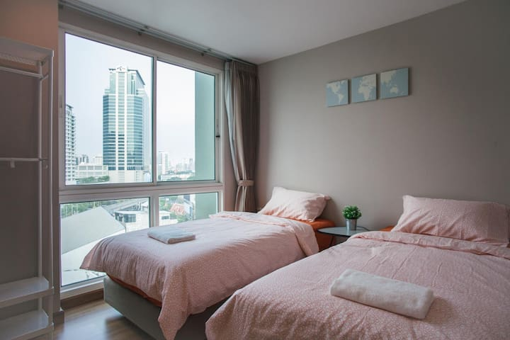 Second bedroom has 2 single size beds.