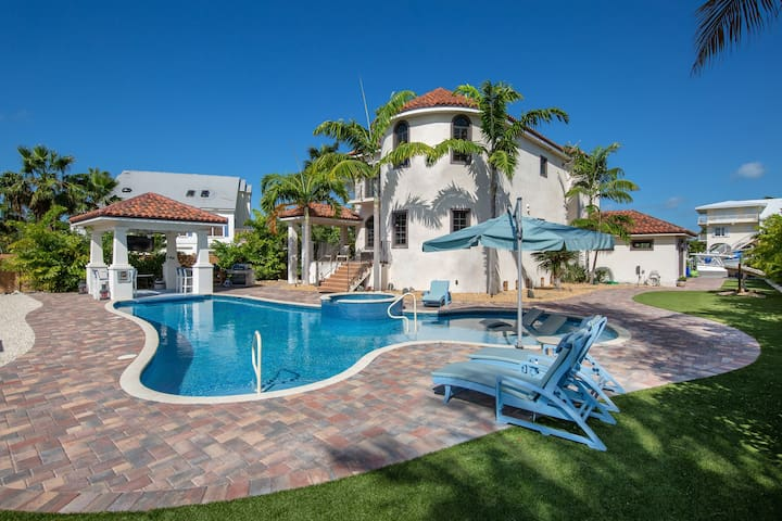 NEW LISTING! Elegant, waterfront home w/ private pools & dock - walk to beach