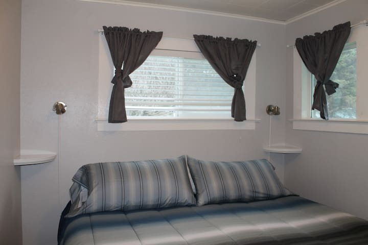 Master king bedroom, with private bathroom. Shower, sink, toilet, linens, and more
