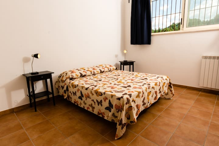 The Bedroom - The comfortable double bed (composed with 2 sigle beds) with soft bed- linen and towels