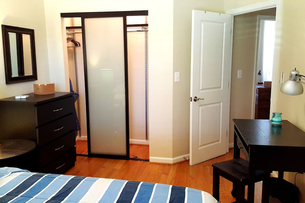 Dresser and nice size and lit wall closet.