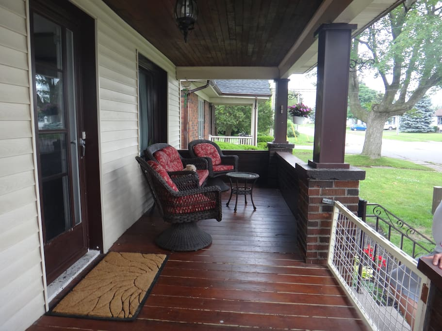 Beautiful front covered porch to enjoy a glass of wine and listen to the falls.
