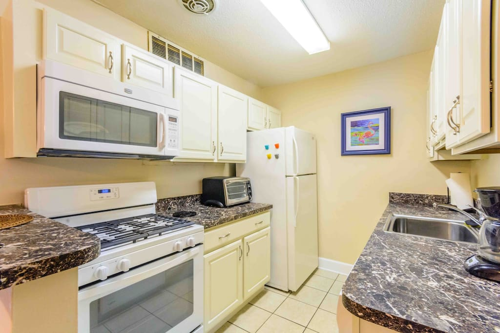 The kitchen has new cabinets, dishwasher, microwave over the stove, new gas stove.  All dishes, cookware, and pans for cooking are included including salt/pepper, paper towels, garbage bags, coffee and other typical kitchen items