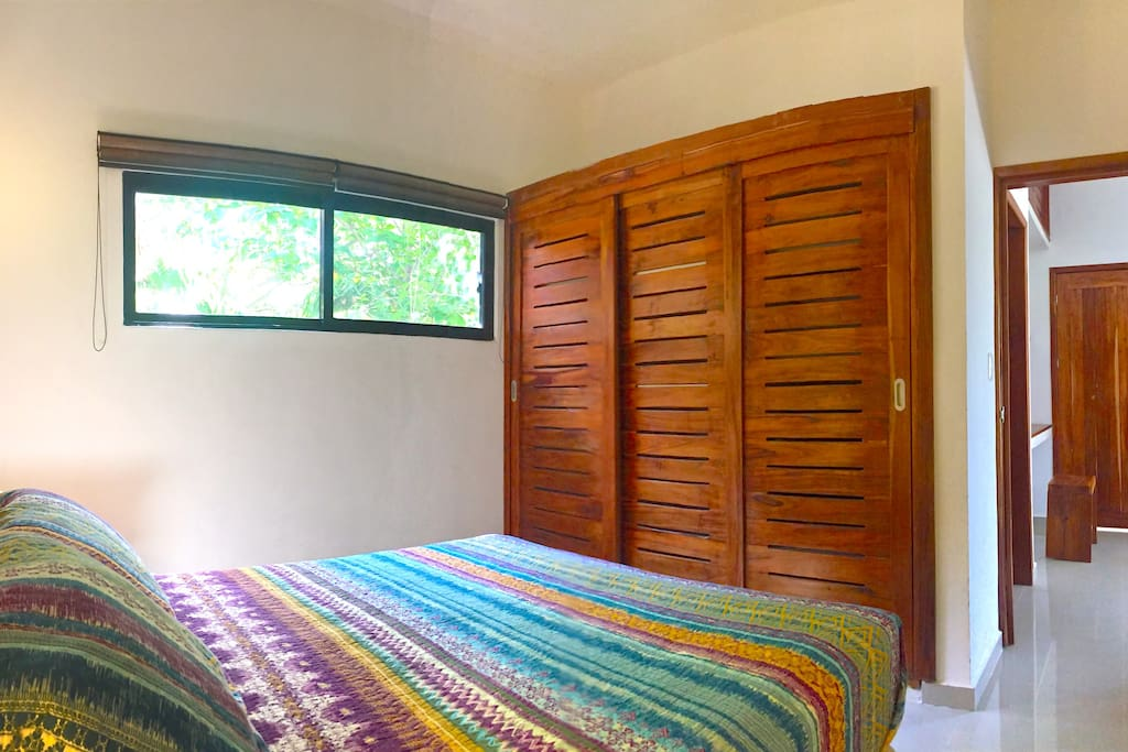 The master bedroom features a large closet