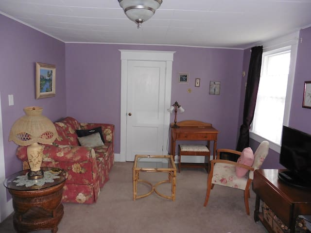 Purple Room - lounging area and desk