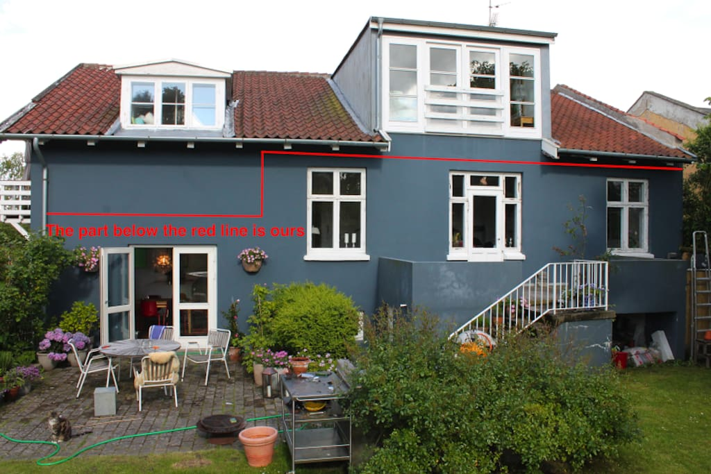 House view from the garden. Above red line is not included
