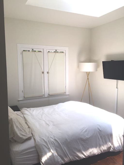 Queen-size bed with skylight and flat screen television. Includes HBO, Showtime, and Apple-TV (Netflix)