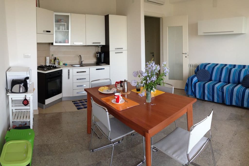 Living room with fully furnished kitchenette