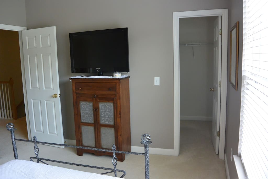TV with local channels and large walk-in closet