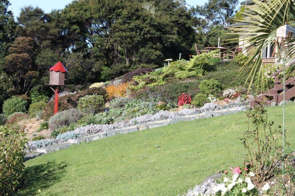 Extensive gardens, native birds, Butterfly grove.
