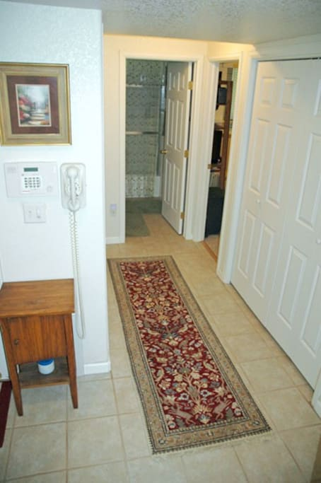 Hallway leading to guest room and bath.